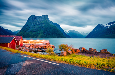 Colorful night scene of Hjorundfjorden fjord, Orsta municipality, More og Romsdal county. Dramatic evening view of Norway. Traveling concept background. Reklamní fotografie