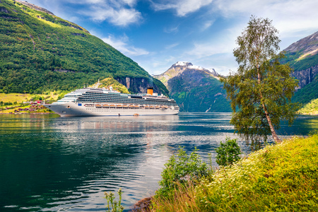 Big cruise ship in Sunnylvsfjorden fjord. Colorful summer morning in Norway, Europe. Traveling concept background. Artistic style post processed photo. Reklamní fotografie - 116546945
