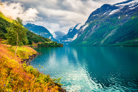 Sunny summer view of Lovatnet lake, municipality of Stryn, Sogn og Fjordane county, Norway.Colorful morning scene in Norway. Beauty of nature concept background.