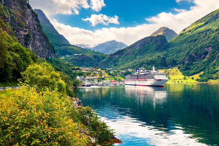 Sunny summer scene of Geiranger port, western Norway. Colorful view of Sunnylvsfjorden fjord. Traveling concept background. Artistic style post processed photo. Foto de archivo - 116546954