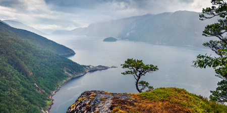 Rainy morning view of Tingvollfjorden flord, Sunndal Municipality in More og Romsdal county. Great aerial scene in Norway, Europe. Beauty of nature concept background.