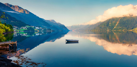 Beautifel summer panorama on the Norwegian fjord, located near Lofthus village in Ullensvang municipality, Hordaland county, Norway. Beauty of countryside concept background. Foto de archivo - 116546988