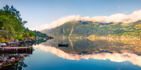 Picturesque summer panorama on the Norwegian fjord, located near Lofthus village in Ullensvang municipality, Hordaland county, Norway. Beauty of countryside concept background. Banque d'images