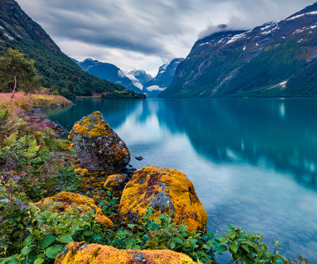 Dramatic summer view of Lovatnet lake, municipality of Stryn, Sogn og Fjordane county, Norway. Picturesque evening scene in Norway. Beauty of nature concept background. Stock Photo