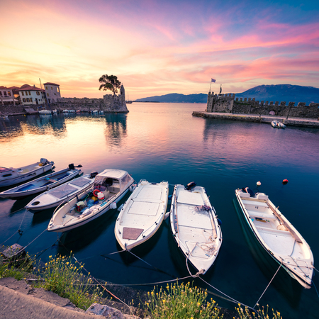 Impressive spring view of the Nafpaktos port. Fantastic sunrise in the Gulf of Corinth, Greece, Europe. Beauty of countryside concept background. Beauty of countryside concept background.