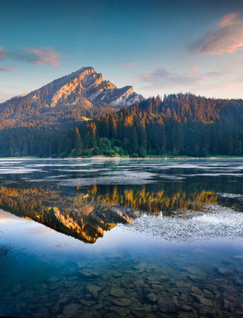Beautiful morning view of the Obersee lake. Colorful summer sinrise in the Swiss Alps, Nafels village location, Switzerland, Europe. Beauty of nature concept background.