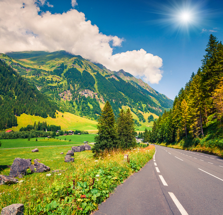 Sunny summer view of famous Grossglockner High Alpine Road. Great morning scene of Austrian Alps, Upper Austria, Europe. Traveling concept background.