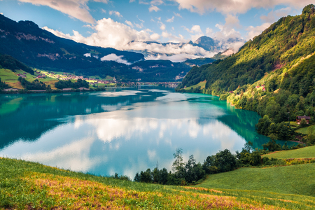 Great summer view of Lungerersee lake. Colorful morning scene of Swiss Alps, Lungern village location, Switzerland, Europe. Beauty of nature concept background. Stock Photo