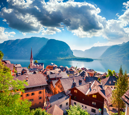 Colorful summer scene of Hallstatt village in the Austrian Alps. Great morning view of  Lutheran Church and Hallstattersee lake, Austria, Europe. Traveling concept background.