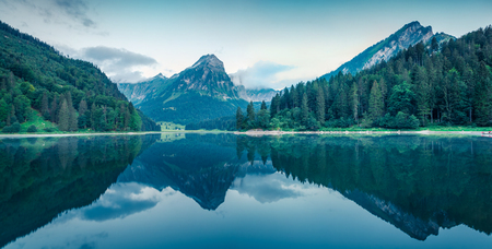 Great summer panorama of the Obersee lake. Green morning scene of Swiss Alps, Nafels village location, Switzerland, Europe. Beauty of nature concept background. 写真素材