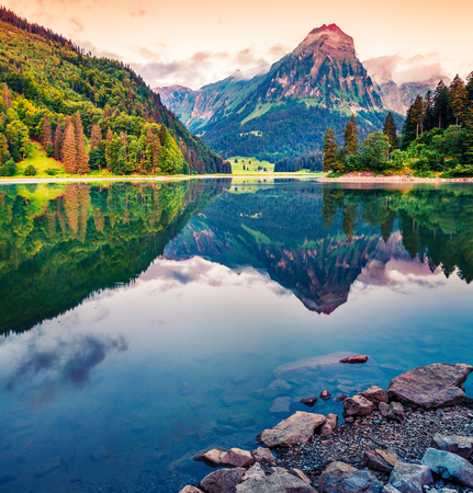 Great morning view of the Obersee lake. Colorful summer sinrise in the Swiss Alps, Nafels village location, Switzerland, Europe. Beauty of nature concept background. Foto de archivo - 116549545