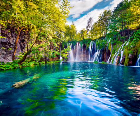 Picturesque morning view of Plitvice National Park. Colorful spring scene of green forest with pure water waterfall. Great countryside landscape of Croatia, Europe.Beauty of nature concept background. Stock Photo