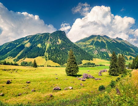Majestic summer view from famous Grossglockner High Alpine Road. Great morning scene of Austrian Alps, Upper Austria, Europe. Beauty of nature concept background.
