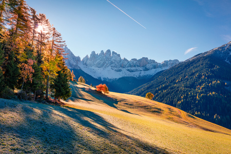 Spectacular view of Santa Maddalena village hills in front of the Geisler or Odle Dolomites Group. Colorful autumn scene of Dolomite Alps, Italy, Europe. Beauty of countryside concept background.