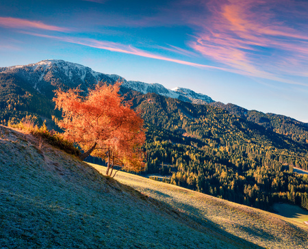 Great morning scene of Santa Maddalena village in front of the Geisler or Odle Dolomites Group. Colorful autumn sunrise of Dolomite Alps, Italy, Europe. Beauty of nature concept background.
