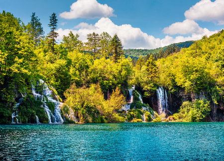 Picturesque morning csene of Plitvice National Park. Colorful spring view of green forest with pure water lake and waterfall. Great countryside view of Croatia, Europe. Traveling concept background.