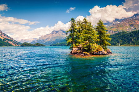 Small island on the Sils lake. Splendid morning scene of Swiss Alps, Maloja pass, Upper Engadine in canton of the Grisons, Switzerland, Europe. Beauty of nature concept background. Stok Fotoğraf