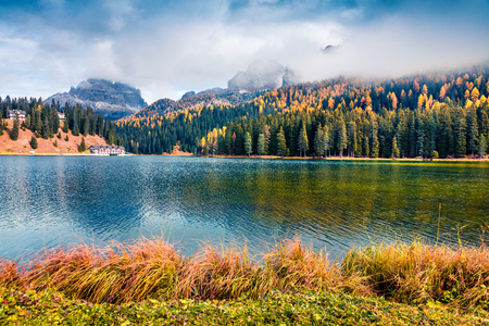 Nice morning scene of Misurina lake in National Park Tre Cime di Lavaredo. Colorful autumn view of Dolomite Alps, South Tyrol, Location Auronzo, Italy, Europe. Beauty of countryside concept background.