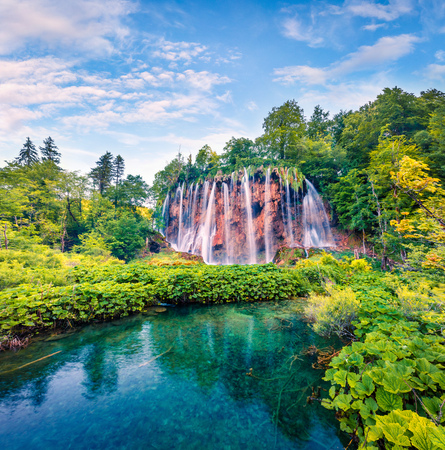 Picturesque morning view of Plitvice National Park. Colorful spring scene of green forest with pure water waterfall. Great countryside landscape of Croatia, Europe. Beauty of nature concept background.