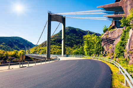 Typical Norwegian view of the bridge across the fjord. Colorful summer morning in the Norway. Traveling concept background. Artistic style post processed photo. Stock Photo