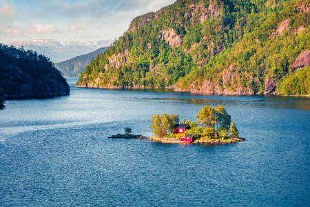 Magnificent summer view with small island with typical Norwegian building on Lovrafjorden flord, North sea. Colorful morning view in Norway. Beauty of nature concept background. Stok Fotoğraf