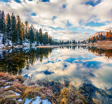 Majestic morning view of Antorno lake. Picturesque autumn scene of Dolomite Alps, Province of Belluno, Italy, Europe. Beauty of nature concept background. Stock Photo