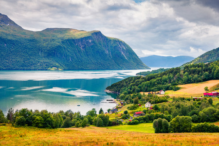Typical countryside Norwegian landscape. Summy summer morning in Norway, Europe. Beauty of nature concept background. Artistic style post processed photo. Stock fotó