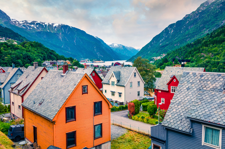 Typical Norwagian architecture in Odda town, Hordaland county, Norway. Beautiful summer view of Hardangerfjord fjord. Traveling concept background. Foto de archivo - 116550235