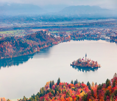 Aerial view of church of Assumption of Maria on the Bled lake. Foggy autumn landscape in Julian Alps, Slovenia, Europe. Beauty of countryside concept background. Stok Fotoğraf - 116550284