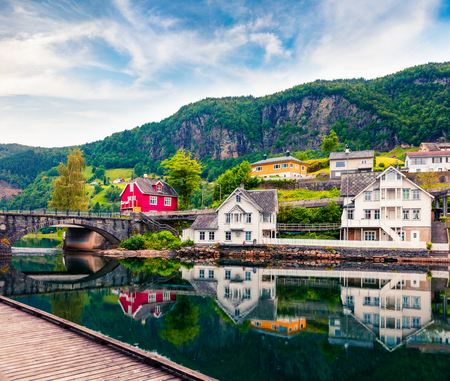 Beautiful summer view of Norheimsund village, located on the northern side of the Hardangerfjord. Colorful morning scene in Norway, Europe. Traveling concept background. Stock Photo