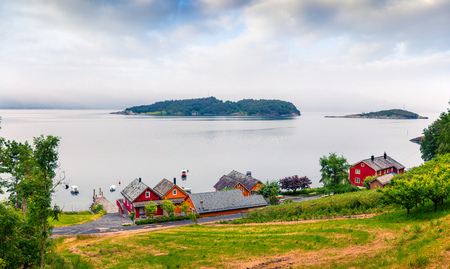 Typical countryside Norwegian landscape. Summy summer morning in Norway, Europe. Beauty of nature concept background. Artistic style post processed photo. Reklamní fotografie