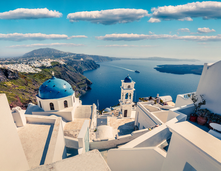 Great aerial view of Santorini island. Picturesque spring scene of the  famous Greek resort Fira, Greece, Europe. Traveling concept background.