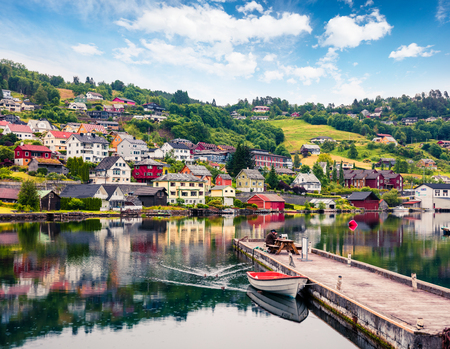 Rainy summer view of Norheimsund village, located on the northern side of the Hardangerfjord. Colorful morning scene in Norway, Europe. Traveling concept background. 스톡 콘텐츠