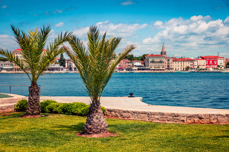Sunny spring view of popular summer resort Porec. Colorful spring seascape of Adriatic Sea. Great morning scene of Istrian Peninsula in western Croatia, Europe. Vacation concept background. Фото со стока
