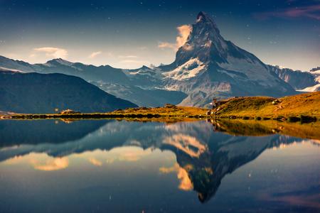 Great night view of the Stellisee lake. Splendid outdoor scene with Matterhorn (Monte Cervino, Mont Cervin) in Swiss Alps, Zermatt location, Valais canton, Switzerland, Europe.