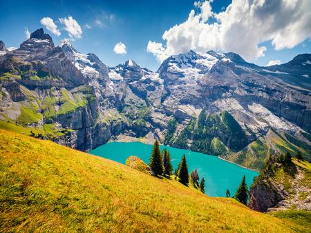 Aerial view of unique Oeschinensee Lake. Splendid outdoor scene in the Swiss Alps with Bluemlisalp mountain, Kandersteg village location, Switzerland, Europe. Beauty of nature concept background. Foto de archivo - 116550472