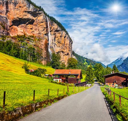 Splendid summer view of waterfall in Lauterbrunnen village. Splendid outdoor scene in Swiss Alps, Bernese Oberland in the canton of Bern, Switzerland, Europe. Beauty of countryside concept background.