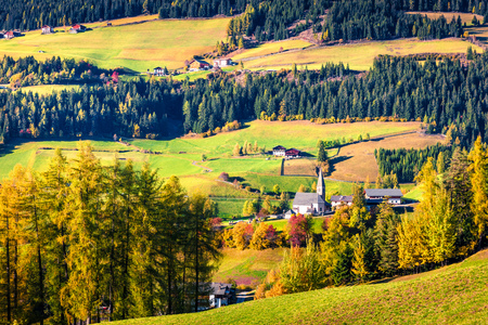 Great morning view of Santa Maddalena village and Chiesa di Santa Maddalena church. Colorful autumn scene of Dolomite Alps, Italy, Europe. Beauty of countryside concept background.