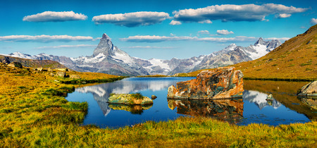 Colorful summer panorama of the Stellisee lake. Great outdoor scene with Matterhorn (Monte Cervino, Mont Cervin) in Swiss Alps, Zermatt location, Valais canton, Switzerland, Europe.
