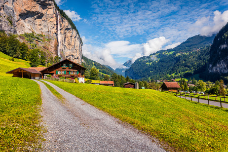 Nice summer view of waterfall in Lauterbrunnen village. Splendid outdoor scene in Swiss Alps, Bernese Oberland in the canton of Bern, Switzerland, Europe. Beauty of countryside concept background. Foto de archivo - 116550499