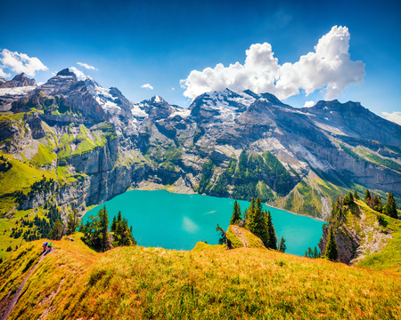 Fabulous summer morning on the unique Oeschinensee Lake. Splendid outdoor scene in the Swiss Alps with Bluemlisalp mountain, Kandersteg village location, Switzerland, Europe. Foto de archivo - 116550516