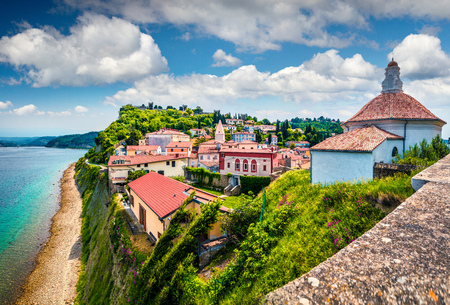 Bright view of old town Piran. Splendid spring morning on Adriatic Sea. Beautiful cityscape of Slovenia, Europe. Traveling concept background. Magnificent Mediterranean landscape.