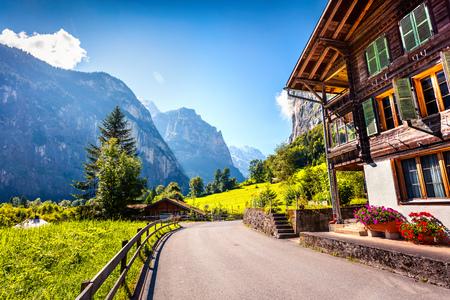 Picturesque summer view of Lauterbrunnen village. Splendid outdoor scene in Swiss Alps, Bernese Oberland in the canton of Bern, Switzerland, Europe. Traveling concept background. Stock Photo