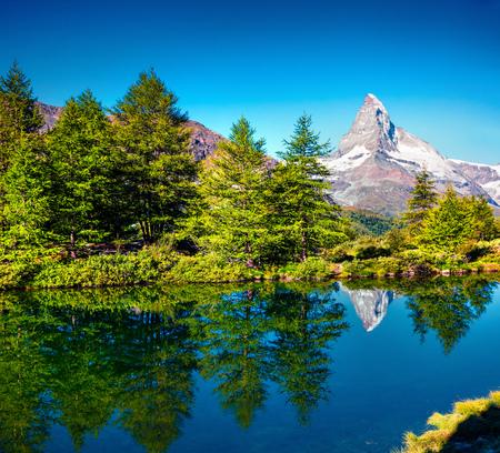 Тшсу summer morning on the Grindjisee lake. Peaceful view of  Matterhorn (Monte Cervino, Mont Cervin) peak, Swiss Alps, Zermatt location, Switzerland, Europe. Beauty of nature concept background. Stock Photo