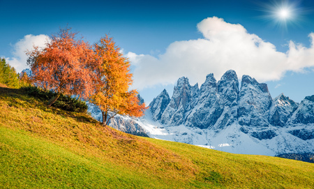 Fantastic view of Santa Maddalena village hills in front of the Geisler or Odle Dolomites Group. Colorful autumn scene of Dolomite Alps, Italy, Europe. Beauty of nature concept background.