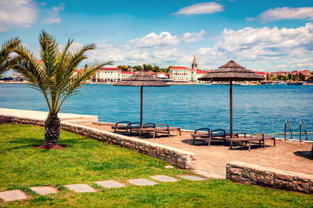 Sunny spring view of popular summer resort Porec. Colorful spring seascape of Adriatic Sea. Great morning scene of Istrian Peninsula in western Croatia, Europe. Vacation concept background. Stock Photo