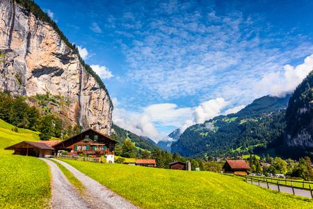 Majestic summer view of waterfall in Lauterbrunnen village. Splendid outdoor scene in Swiss Alps, Bernese Oberland in the canton of Bern, Switzerland, Europe. Beauty of countryside concept background. Stock Photo