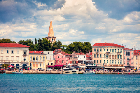 Nice morning cityscape of popular summer resort Porec. Colorful spring seascape of Adriatic Sea. Great  scene of Istrian Peninsula in western Croatia, Europe. Traveling concept background. Stock Photo