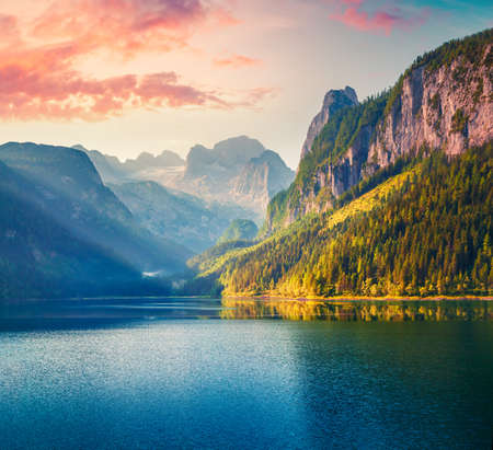 Fabulous summer sunrise on Vorderer ( Gosausee ) lake. Impressive morninf scene of Austrian Alps. Upper Austria, Europe. Beauty of nature concept background. Foto de archivo - 116551250