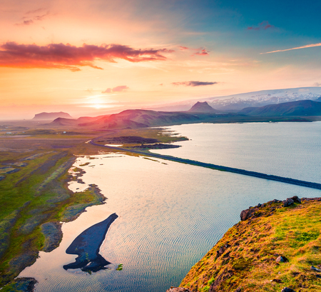 Aerial evening view from the Dyrholaey peninsula, Atlantic ocean. Summer sunset in South Iceland, Vic village location, Europe. Beauty of nature concept background. Stock Photo